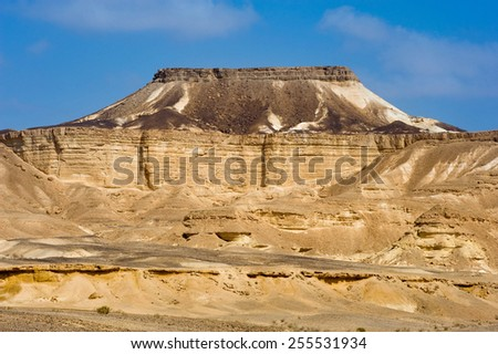 Table shape mountain in the Makhtesh ramon crater in the negev desert - stock photo