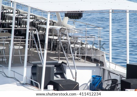 table standing on the deck of a ship - stock photo