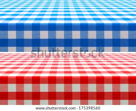 table surface perspective view covered by red and blue checkered tablecloth - stock photo