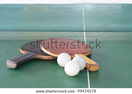 Table tennis ball and net - stock photo