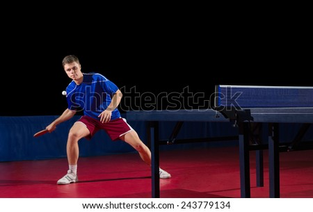 Table tennis player isolated on black - stock photo