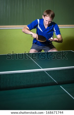 table tennis player serves