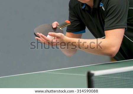 table tennis player serving - stock photo