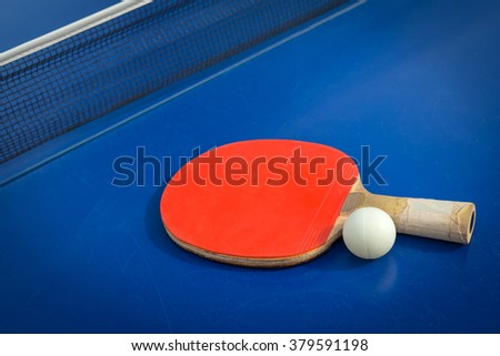 table tennis racket and ball on table - stock photo