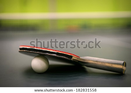 table tennis racket with ball - stock photo