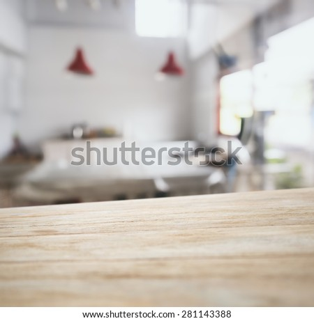 Table top counter bar display with Blurred kitchen Interior background - stock photo