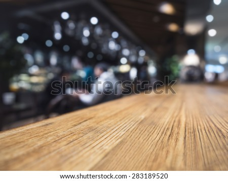 Table top counter Bar restaurant background with people - stock photo