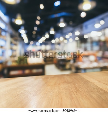 Table top Counter Bar with Blurred Retail shop store Background - stock photo