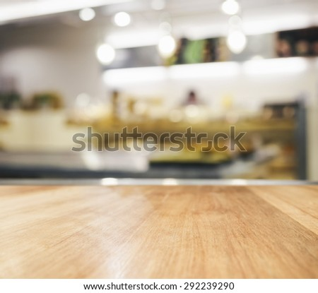 Table top Counter with Blurred Kitchen interior background - stock photo