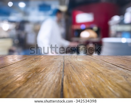 Table Top with Blurred Chef Cooking Pizza Italian restaurant Background  - stock photo