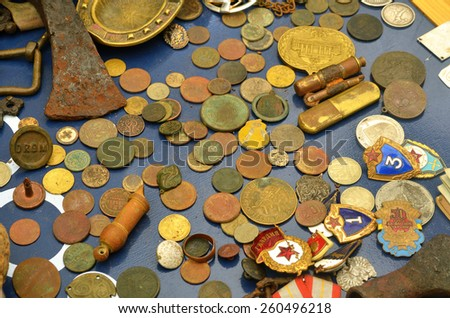 table with antique coins and Orders - stock photo