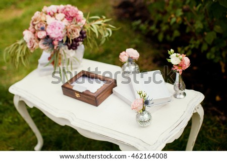 table with box for wedding wishes, flowers and books