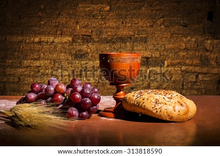 table with bread, wine, wheat and grapes for the consecration - stock photo