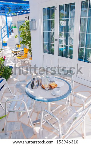 Table with breakfast in the garden with flowers at the hotel. - stock photo