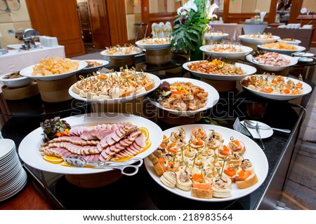 Table with catering food - stock photo