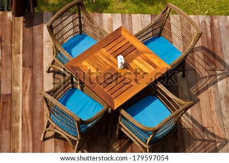 table with chair in the green garden - stock photo