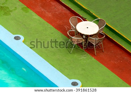 Table with chairs at The Pool - stock photo