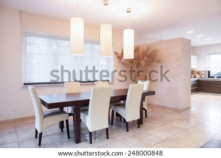 Table with chairs in dining room, horizontal - stock photo