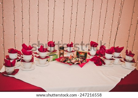 Table with entertainments and tea services.