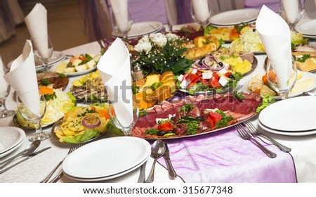 Table with food and decoration for celebrations and banquets