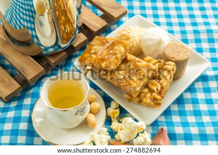 Table with some Brazilian delicious. Festa Junina Theme - stock photo