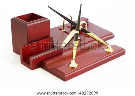 table wooden stationery set, a white background - stock photo
