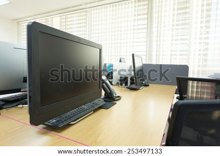 table work in office with black computer pc