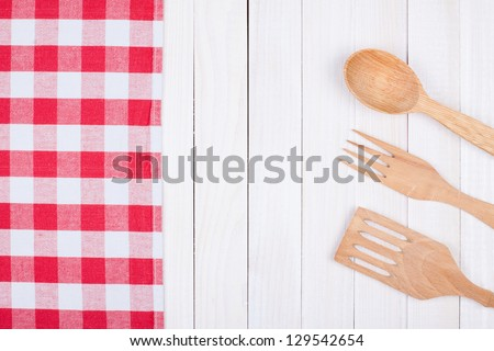 Tablecloth, kitchen equipment on white wood background - stock photo