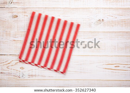 Tablecloth napkin on white wooden table for dinner, menu in restaurant Top view horizontally. Flat mock up for design.Table place setting.  - stock photo