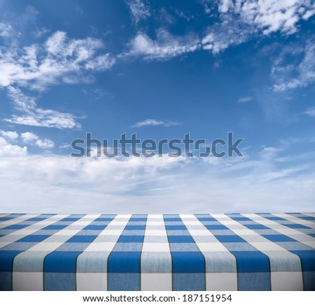 Tablecloth on blue cloudy sky - stock photo
