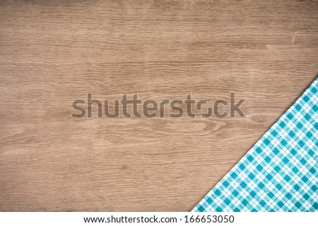 Tablecloth on old wooden table textured background - stock photo