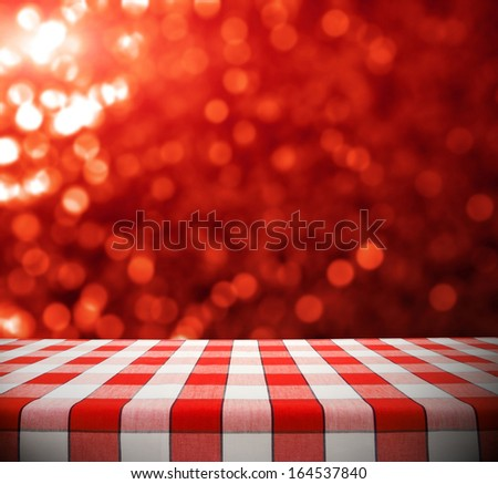 Tablecloth on red bokeh background - stock photo
