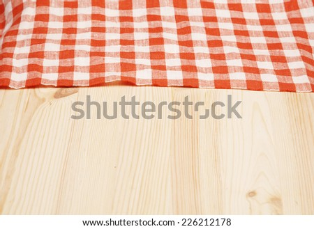 Tablecloth red and white checkered wavy  on board