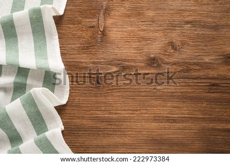 Tablecloth textile on wooden background   - stock photo