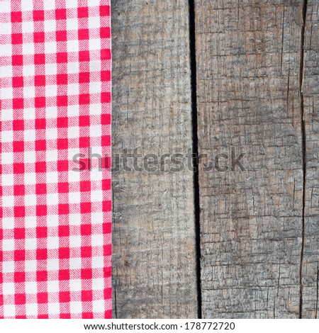 Tablecloth textile texture on wooden table background - stock photo