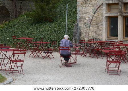 Tables and chairs at a old cafe restaurant - stock photo