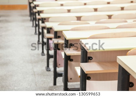 tables and chairs in a college classroom