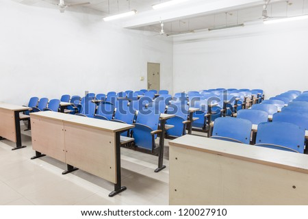 tables and chairs in a empty classroom