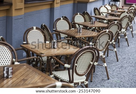 tables and chairs in Cafe - stock photo