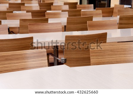 Tables and chairs in many rows. - stock photo