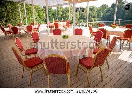 tables and chairs in the restaurant outdoors - stock photo