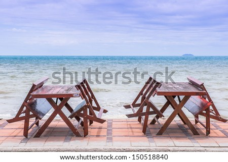Tables and chairs near the sea