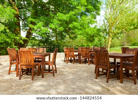 Tables and chairs of outdoor cafe in England - stock photo
