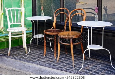 Tables and chairs outside a town centre cafe, Buxton, Derbyshire, England, UK, Western Europe.