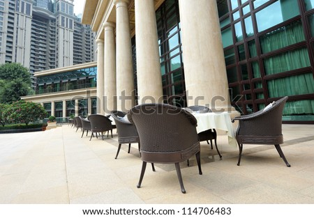 Tables and chairs ready for diners at an outdoor cafe