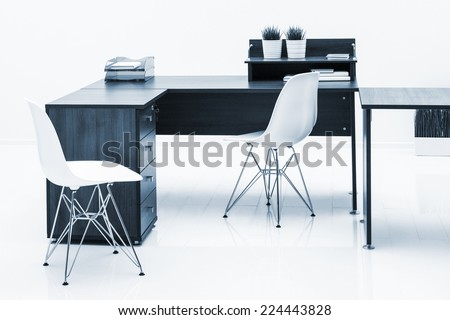 tables and plastic chairs with reflection on white background - stock photo