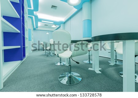 tables and white chairs in the empty modern library - stock photo