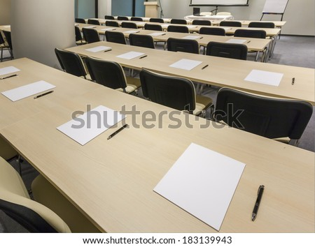 Tables prepared for conference in modern conference hall