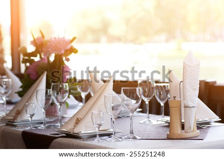 Tables set and salad served for a wedding reception.  - stock photo