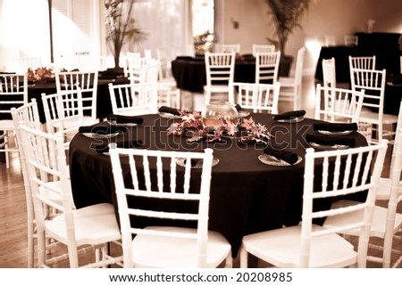 tables set up for wedding reception - stock photo